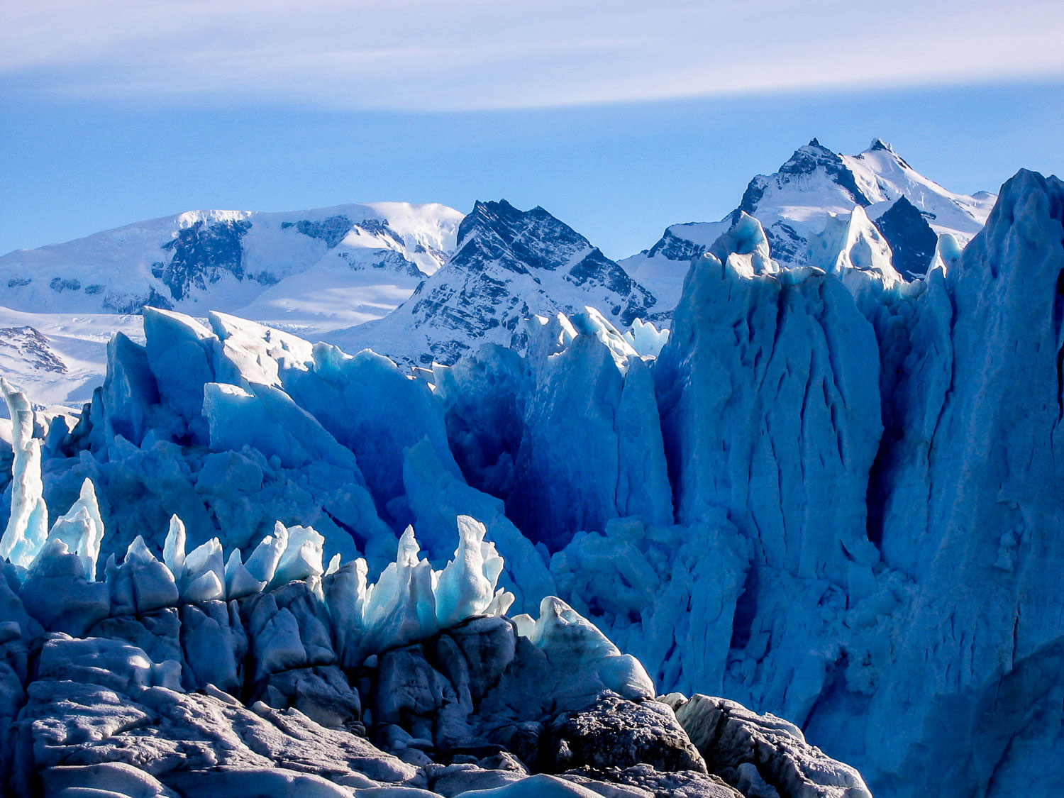 A Close-up Photograph Showing The Blue Ice Of The Perito Moreno Glacier In Argentina.