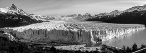 A Panoramic Black And White Photograph Of The Perito Moreno Glacier In Argentina.