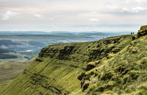 A Landscape Photograph Showing The Craig Gwaun Taf Escarpment With Hikers Making Their Way Along On The Way To Corn Du In The Brecon Beacons National Park, Wales.