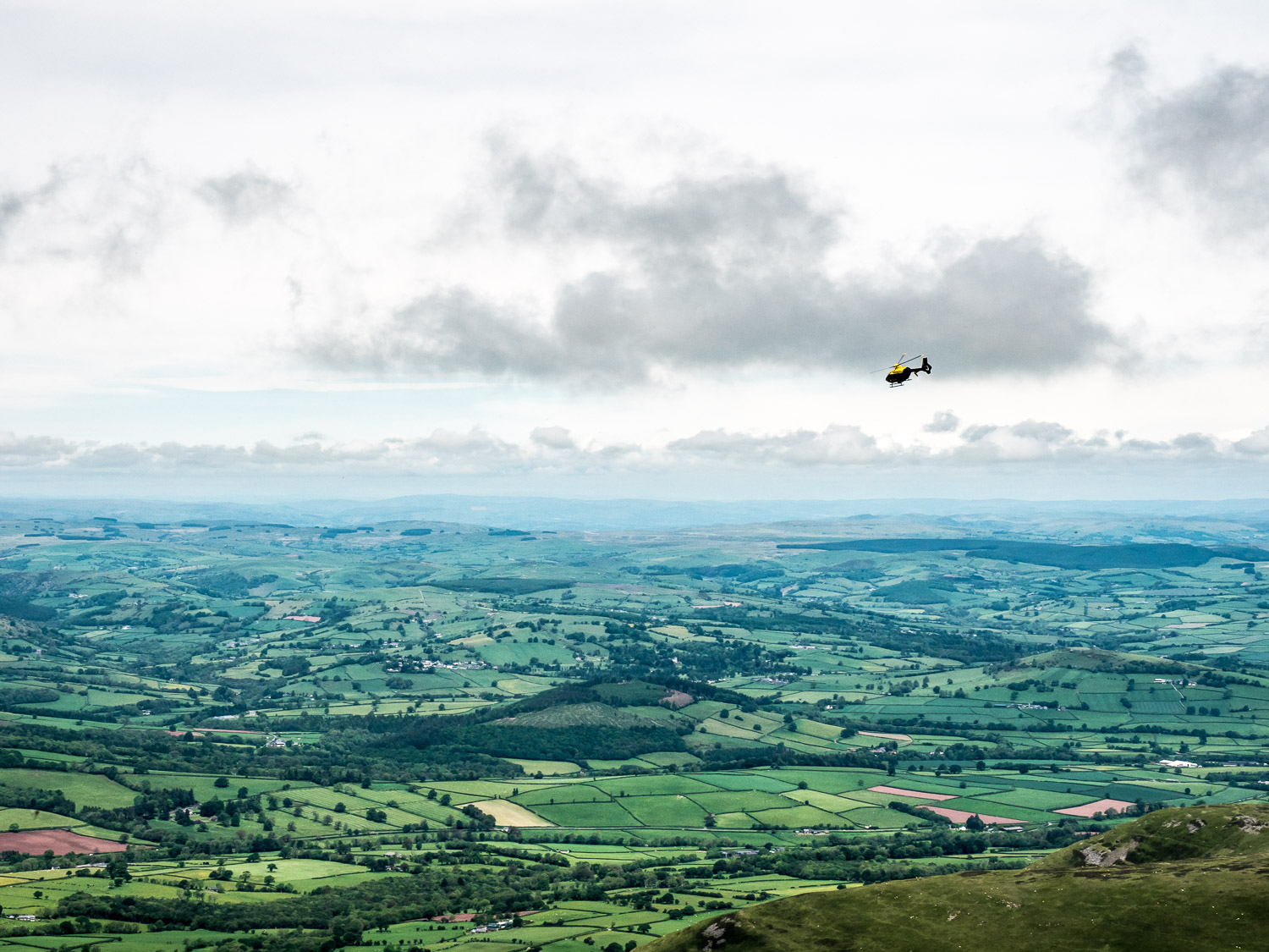 A Landscape Photograph Showing A Helicopter That Has Just Flown Over Pen Y Fan In The Brecon Beacons National Park, Wales.