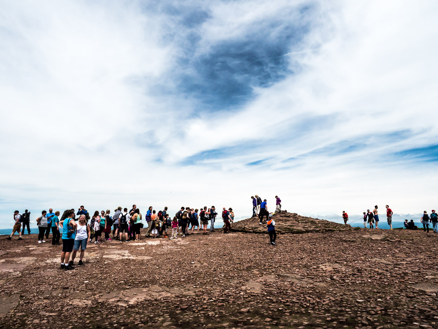 A Landscape Photograph Showing Hikers Queuing To Take Summit Selfies On The Summit Of Pen Y Fan In The Brecon Beacons National Park, Wales.