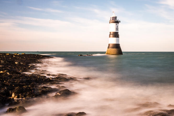 A Long Exposure Photograph Of Trwyn Du Lighthouse At Penmon Point, Anglesey, UK.