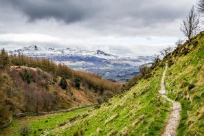 A Photograph Showing The Precipice Walk In Snowdonia With The Snow-covered Cadair Idris Mountain In The Background.