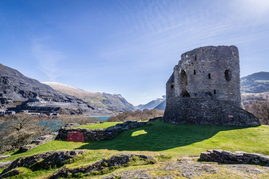 A high dynamic range photograph of Dolbadarn Castle in Snowdonia, showing detail in both the sky and the shadow. This is HDR photography.