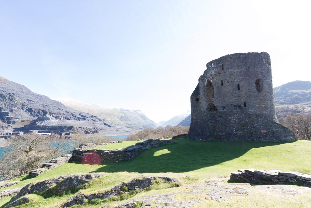 A high exposure photograph of Dolbadarn Castle in Snowdonia, showing detail in the shadows but a washed out sky.