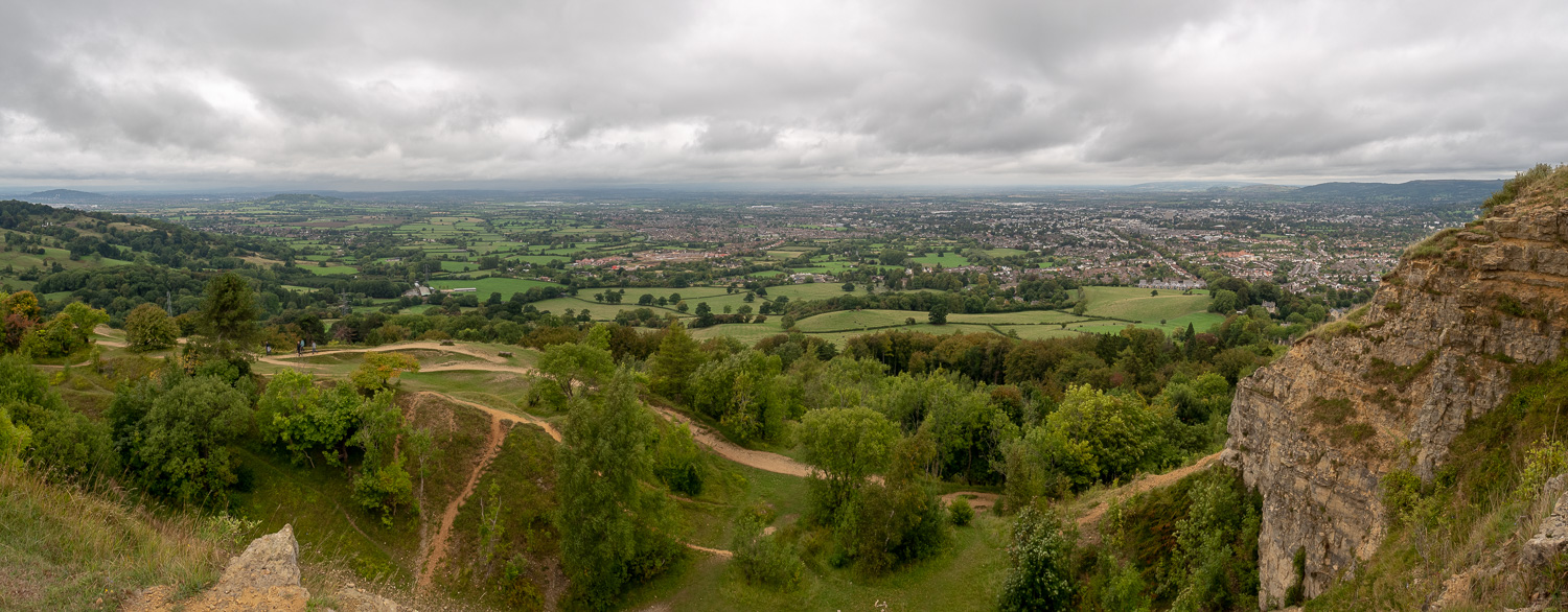 A Panoramic Photograph Showing The View Over Cheltenham From Leckhampton Hill On The Cotswold Way