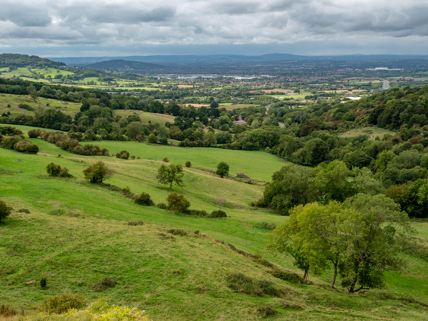 A Landscape Photograph Showing Fields And Hills Into The Distance On The Cotswold Way.