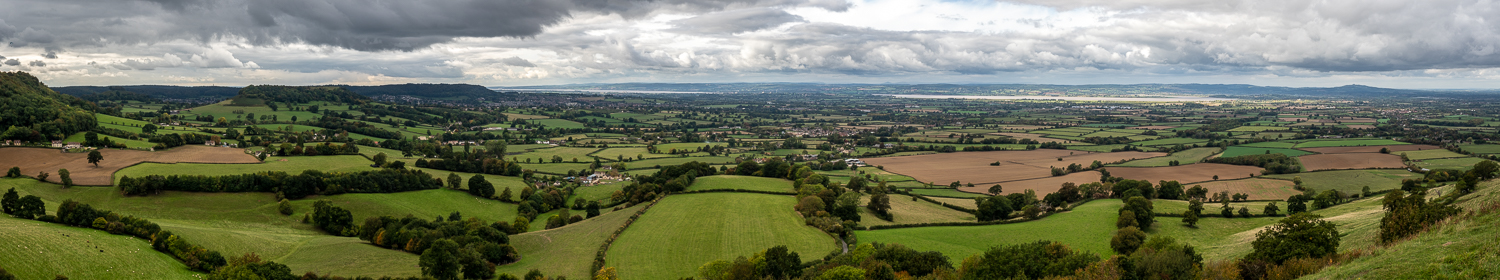 A Wide Panoramic Photograph Showing A Patchwork Of Fields On The Cotswold Way.