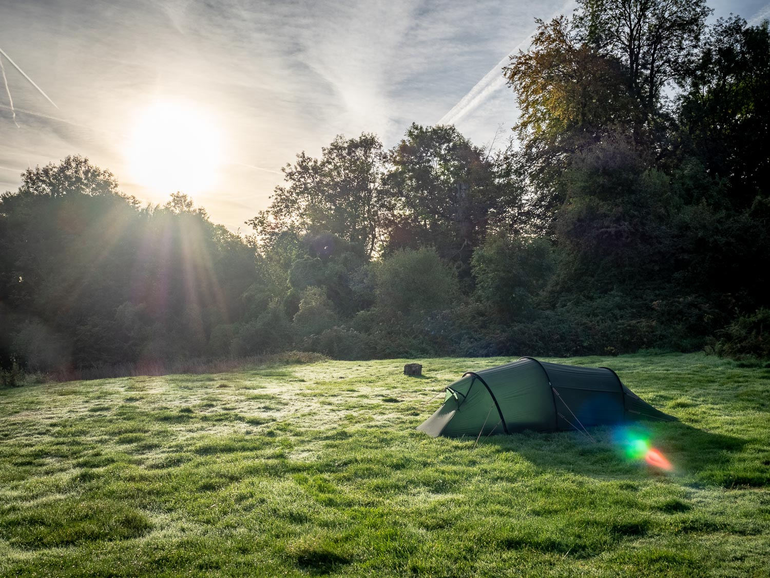 A Photograph Showing A Hilleberg Nallo Tent In Frost In Front Of A Rising Sun At The Thistledown Campsite Near Stroud, Gloucestershire.