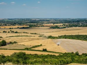 A Landscape Photograph Showing The View From Beacon Hill Near Ivinghoe In The Chilterns. A Wide Range Of Arable Fields Are Shown, Including A Combine Harvester.